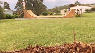 Backyard ramp boys scooter faceplant - Video