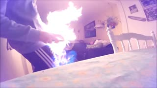 Guy green table lights long lighter and living room on fire screams - Video