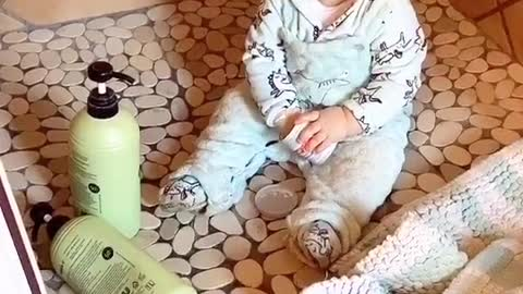Naughty baby makes huge mess in the shower, feels no remorse