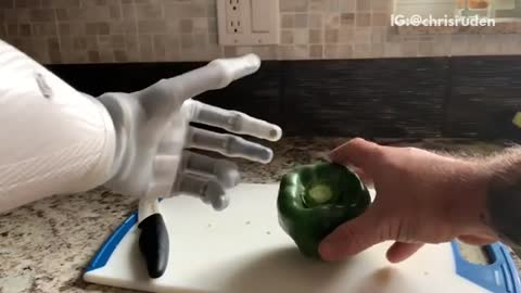 Guy cuts green bell pepper with bionic arm and smashes it