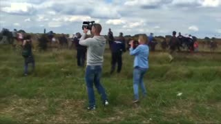 Migrant trip camerawoman caught on video - Video