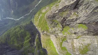 Breathtaking POV wingsuit flight over glacier