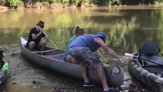 Canoe Slams Into Rocks After Being Launched Backwards