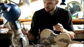 London Based Artist Paints Biographies On Violins - Video