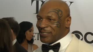 Boxing champ Mike Tyson helps Las Vegas crash victim - Video