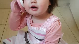 Adorable toddler uses shoe as personal telephone