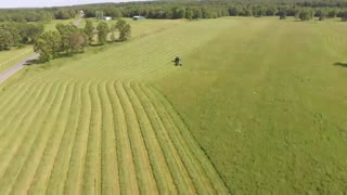 A Tractor Mowing The Field