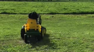 Kid Nods Off Driving Toy Tractor