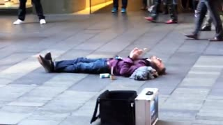 Beatboxing Busker Performs for Supine Spectator