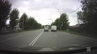 Van Swerves Into and Snaps Power Pole
