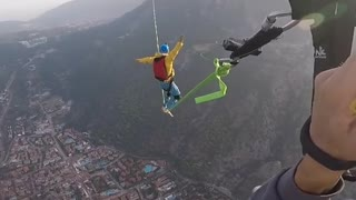 Watch this skydiver fall while trying to walk a tightrope