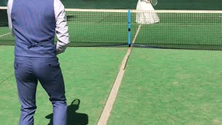 Bride and Groom Play Game of Tennis