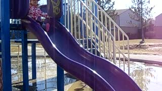 Little Girl Faceplants Off Of Slide Into Giant Puddle - Video