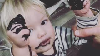 Baby eating paint