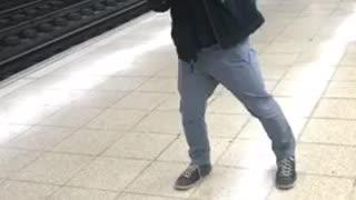 Guy in black jacket dancing with crutch