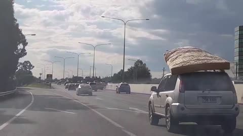 Car Drives With Mattress Loosely Secured