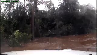 Guy Accidentally Drives Into A Flooded River  - Video