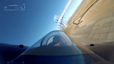 Cockpit view captures stunt plane's amazing low altitude cross