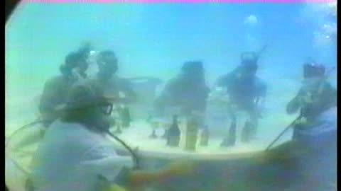 Scuba Divers Have Some Drinks Underwater