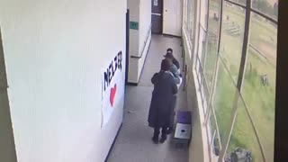 High school coach disarms student with a hug