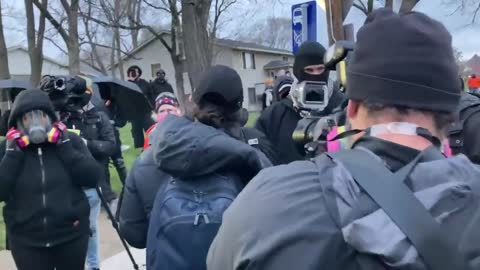 Minnesota: CNN Crew Member Gets Bottle To Head, Fakes Falling Out
