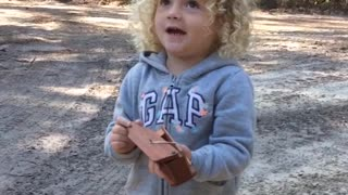 Little Girl Does Turkey Call with Wooden Contraption - Video