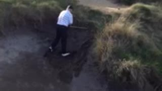 Golfer Takes A Tumble In The Trap