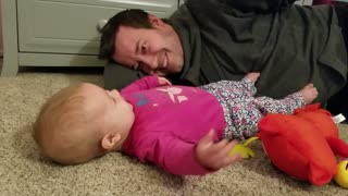 Baby hilariously anticipates dad's tickles