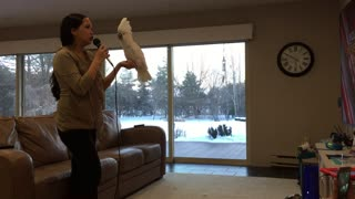 Woman Sings Karaoke With Her Cockatoo Partner