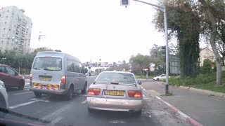 Cyclist has insanely close call with turning vehicle - Video