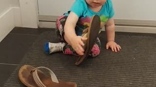 Baby girl trying sandals for the first time