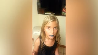 Girl Gets Caught Red Handed Eating Blue Food Coloring - Video