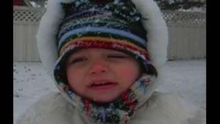 Tiny Tot Attempts To Sing Jingle Bells In A Winter Wonderland - Video