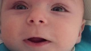 Cute baby imitates dad's voice during a conversation and then... - Video