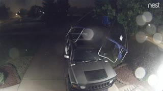 Wind Blows Trampoline onto Hummer SUV - Video