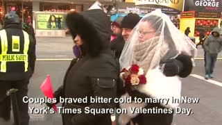 Couples tie cold knots from Times Square - Video