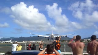 The View of an Airbus A-340 from Maho Beach - Video