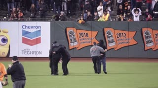 Fan Rushes Field, Gets Tackled by Security at Giants Game - Video