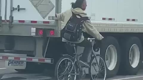 A Toronto Man On A Bike Was Caught Hanging Onto The Back Of A Truck While Cruising Down The Road