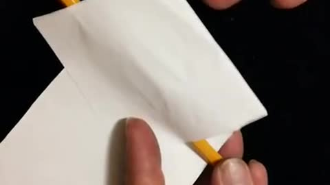 Pencil melts thru bill without damage to paper? How?