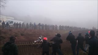 Motocross rider crashes through fence into crowd - Video