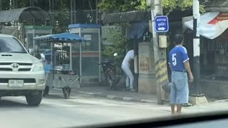 Lending a Helping Hand to Elderly Lady Crossing Street
