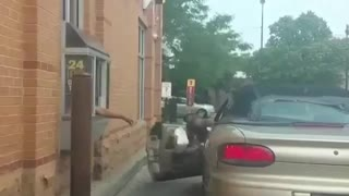 Guy Falls Out Of Car In Drive Through Line - Video