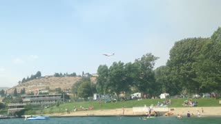 Lake Chelan Fire Retardant Plane Drops Load Over Town - Video