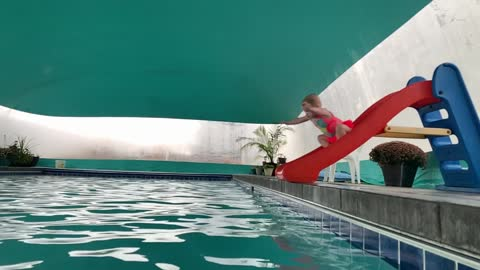 Lana sliding/diving into pool
