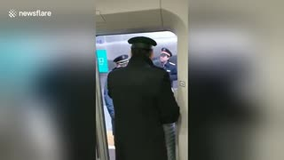 Woman refuses to leave train because her husband is not on it - Video