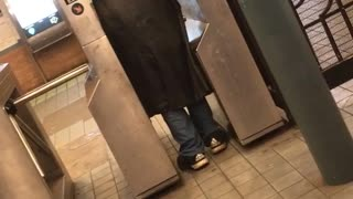 Man on at subway entrance yells - Video