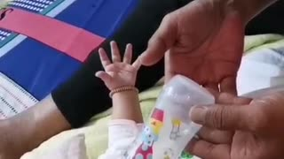 Father give milk for baby