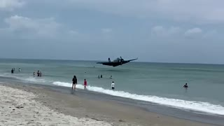 WWII plane forced to crash land on busy Florida beach