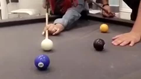 Red hair girl misses purple ball in pool
